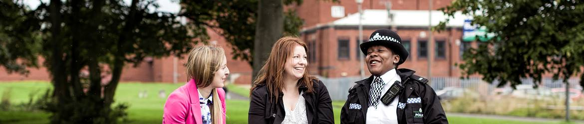 Two women talking to a police officer