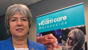 PCC Jane Kennedy in front of a Victim Care Merseyside banner